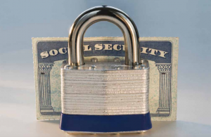 decorative image of a lock with a social security card behind it.
