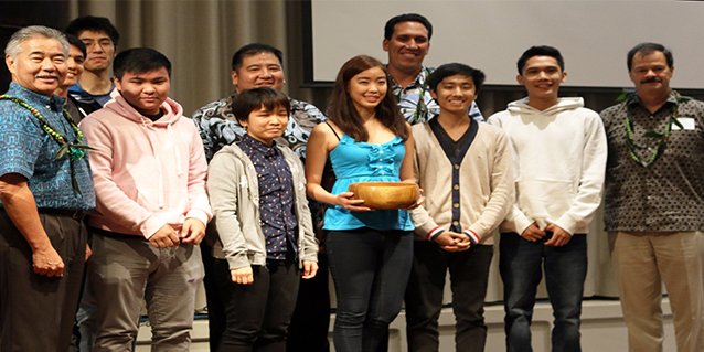 Picture of Team Pika with the governor at the Hawaii Annual Code Challenge (HACC).